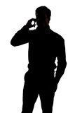 Man talking on cell phone. In silhouette isolated over white background Royalty Free Stock Photos