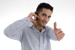 Man talking on cell phone and wishing goodluck Royalty Free Stock Photos