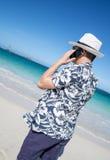Man Talking on a Cellphone on a Caribbean Beach Stock Photography