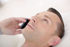 Man talking on cellular phone Stock Images