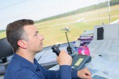 Man talking into control tower receiver. Control stock photos