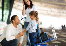 Man talking daughter airport Stock Photo