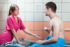 Man talking with doctor before balneotherapy Royalty Free Stock Photo
