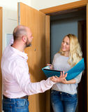 Man talking with employee with paper Stock Photography