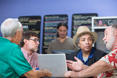 Man Talking with Friends in Cafe Royalty Free Stock Image