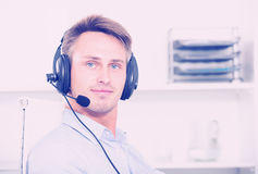 Man talking on headset at office. Man talking on headset at company office Stock Image