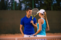 Man talking with her girlfriends at tennis court Royalty Free Stock Images