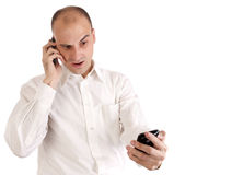 Man talking on his cell phone. A businessman looks shocked while talking on his cell phone Stock Image