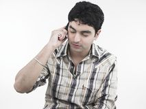 Man talking on his cell phone. With a worried expression Stock Images