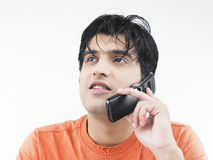 Man talking on his cell phone. Asian adult male talking on his cell phone Royalty Free Stock Photos