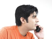 Man talking on his cell phone. Asian adult male talking on his cell phone Stock Photos