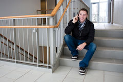 Man Talking on His Cell Phone in the Stairwell Royalty Free Stock Photo