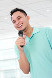Man talking with microphone Stock Images