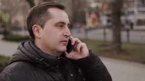 Man talking on mobile cell phone using smartphone outdoor stock footage