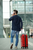 Man talking on mobile phone in airport Royalty Free Stock Photography