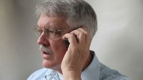 Man talking on mobile phone stock footage