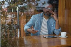 Man talking on mobile phone. In caf Royalty Free Stock Image