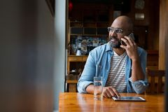 Man talking on mobile phone. In caf Royalty Free Stock Photo