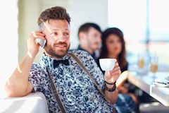 Man talking the mobile phone in cafe Stock Images
