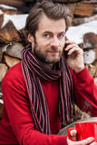 Man talking on a mobile phone outdoor during winter Stock Images