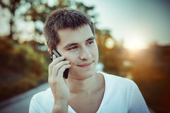 Man talking by the mobile phone outdoors Stock Photo