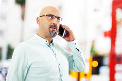 Man talking mobile phone outdoors Royalty Free Stock Image