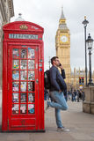 Man talking on mobile phone, red telephone box and Big Ben. London, England Royalty Free Stock Photography
