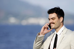 Man talking on mobile phone Stock Images