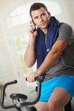 Man talking on mobile after training Stock Image