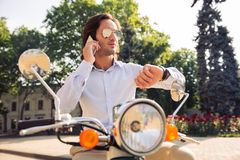 Free Man Talking On The Phone Outdoors Royalty Free Stock Image - 56194656