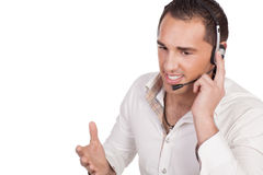 Man talking over a headset Royalty Free Stock Photography