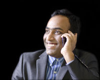 A handsome man talking on phone Royalty Free Stock Images