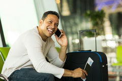 Man talking phone airport stock photo