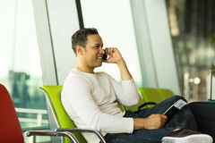 Man talking phone airport Royalty Free Stock Image