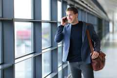 Man talking on phone in airport - travel lifestyle royalty free stock images