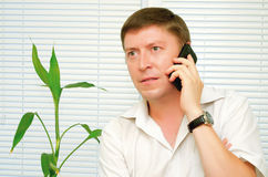 Man talking on the phone. Businessman talking on a cell phone Royalty Free Stock Photos