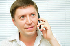 Man talking on the phone. Businessman talking on a cell phone Stock Images