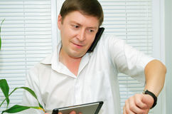 Man talking on the phone. Businessman talking on a cell phone Royalty Free Stock Images