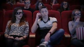 Man talking by phone at cinema stock footage