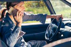 Man talking on phone while driving car. Royalty Free Stock Images