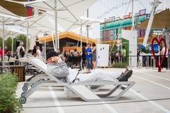 Man talking on phone at Expo 2015 in Milan, Italy Royalty Free Stock Image