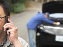 Man Talking on Phone for Fixes Car Royalty Free Stock Images
