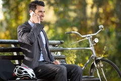 Man talking on the phone with his bicycle Royalty Free Stock Photo