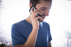 Man talking on the phone. Inside office royalty free stock image