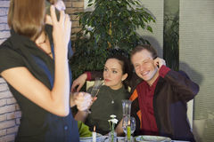 Man talking on phone with lover. In a restaurant Royalty Free Stock Photography