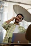 Man talking on phone in office Stock Photo
