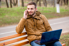 Man talking on the phone outdoors Royalty Free Stock Photos