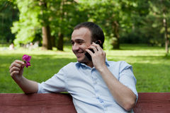 Man talking by phone in the park Royalty Free Stock Photos