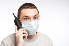 Man talking by phone in protective mask Royalty Free Stock Images
