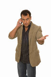 Man talking on the phone and reaching out his hand. Isolated on white stock images